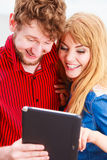 Young couple with tablet outdoor Stock Photo