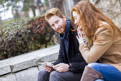 Young couple with tablet Stock Photos