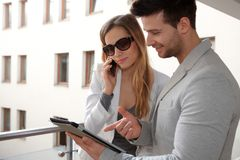 Young couple with tablet outdoors Royalty Free Stock Photos