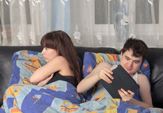 Young couple with tablet PC in their bed Stock Photo