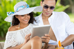 Young couple with tablet pc at tropical resort Royalty Free Stock Photos