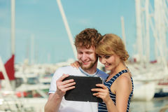 Young couple with tablet by seaside outdoor Royalty Free Stock Photography