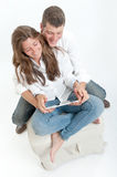 Young couple and tablet Stock Photography