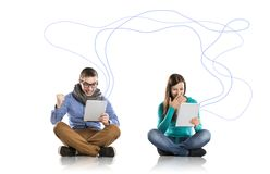 Young couple with tablets Stock Photo