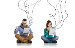 Young couple with tablets Stock Images