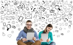 Young couple with tablets Royalty Free Stock Photography