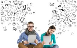 Young couple with tablets Stock Image