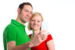 Young couple take self-portrait Royalty Free Stock Images