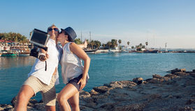 Young couple take their kissing self photo Stock Images