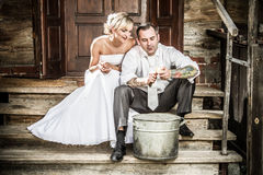 Young couple takes potatoes for wedding ceremonies stock photo