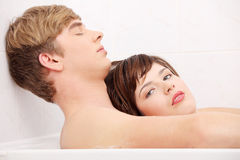 Young couple taking a bath. Royalty Free Stock Photos