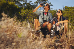 Young couple taking a break on hike Stock Photo