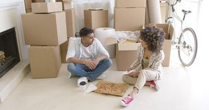 Young couple taking a break from moving house stock footage