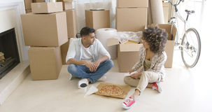 Young couple taking a break from moving house Stock Image