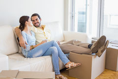 Young couple taking a break from unpacking Stock Photography