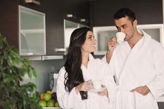 Young couple taking fresh morning cup of coffee Stock Photos