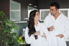 Young couple taking fresh morning cup of coffee Royalty Free Stock Photography