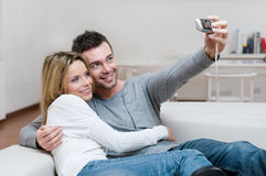Young couple taking a photo Royalty Free Stock Images