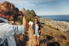 Young couple taking a photo while hiking in the mountains Royalty Free Stock Photos