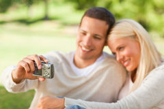 Young couple taking a photo of themselves Royalty Free Stock Photos