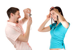 Young couple taking a photo of themselves. (isolated on white stock images
