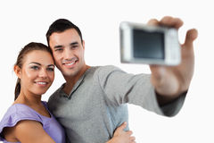 Young couple taking photograph of themselves Royalty Free Stock Photography