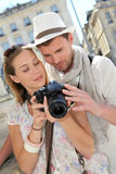 Young couple taking photos in the city Royalty Free Stock Photo