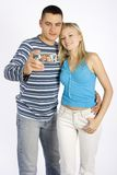 Young couple taking picture by phone/palmtop Royalty Free Stock Image