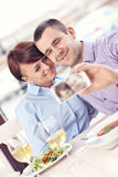 Young couple taking a picture in a restaurant Royalty Free Stock Image