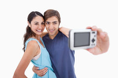 Young couple taking a picture of themselves Royalty Free Stock Photos