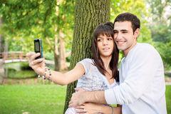 Young couple taking picture of themselves Stock Photography