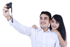 Young couple taking a picture Royalty Free Stock Image