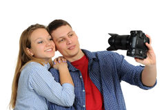 Young couple taking pictures Royalty Free Stock Image
