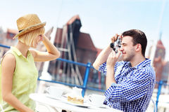Young couple taking pictures in a cafe Royalty Free Stock Image