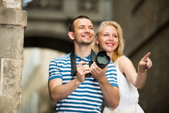 Young couple taking pictures outdoors Stock Image