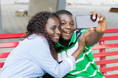 Young couple taking pictures with their mobile phone. Stock Photography