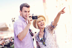 Young couple taking pictures on a tour Stock Images