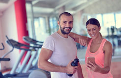 Young couple taking a sefie in a gym Stock Images