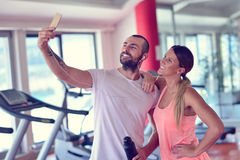 Young couple taking a sefie in a gym Royalty Free Stock Photo