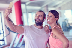 Young couple taking a sefie in a gym Stock Photos