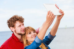 Young couple taking self picture selfie with tablet Royalty Free Stock Photos