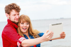 Young couple taking self picture selfie with tablet Royalty Free Stock Photography