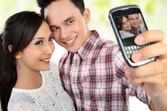Young couple taking self portrait Stock Photo