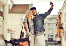 Young couple taking self portrait photo at old camera Stock Photos