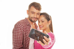 Young couple taking a self-portrait Stock Photography