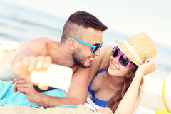 Young couple taking selfie at the beach Stock Photography