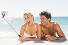Young couple taking selfie on beach Stock Image