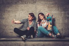 Young couple taking selfie outdoors Stock Photo