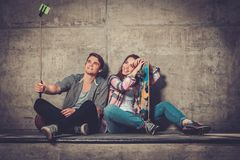 Young couple taking selfie outdoors Stock Photos