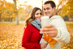 Young couple taking selfie in park Royalty Free Stock Photography